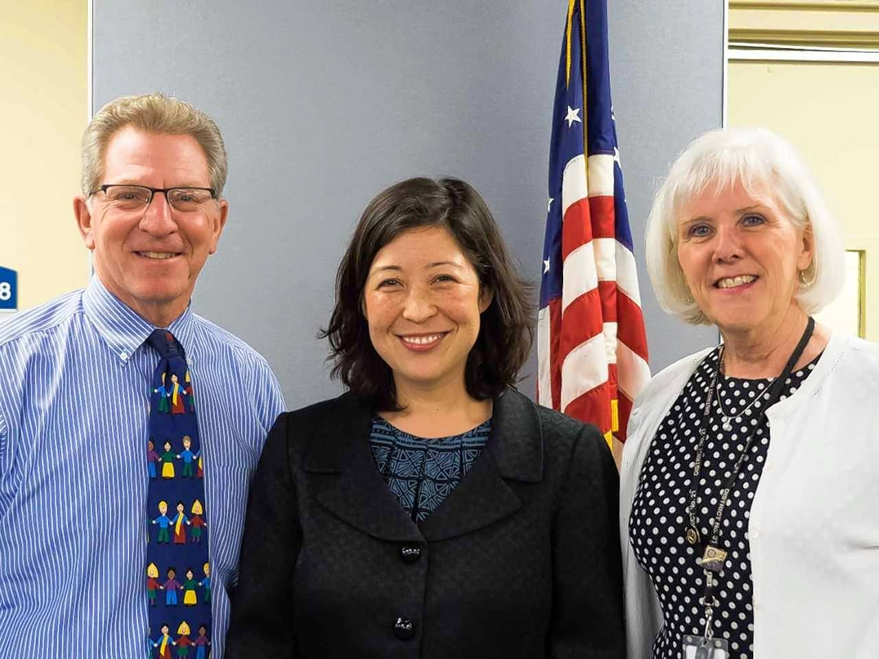 From left, Wheeling Township Elementary District 21 Board of Education President Phil Pritzker, newly appointed member Jennifer Tani and Superintendent Kate Hyland at Thursday's meeting.