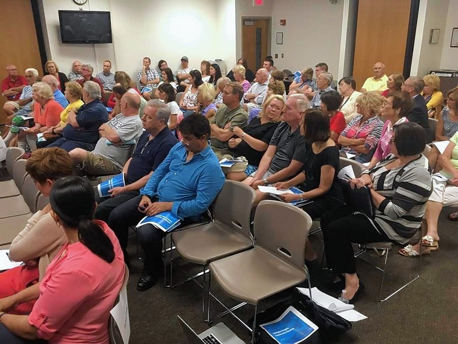 Arlington Heights residents who live in Elk Grove Township District 59 attended a meeting Thursday about test scores affecting home values.