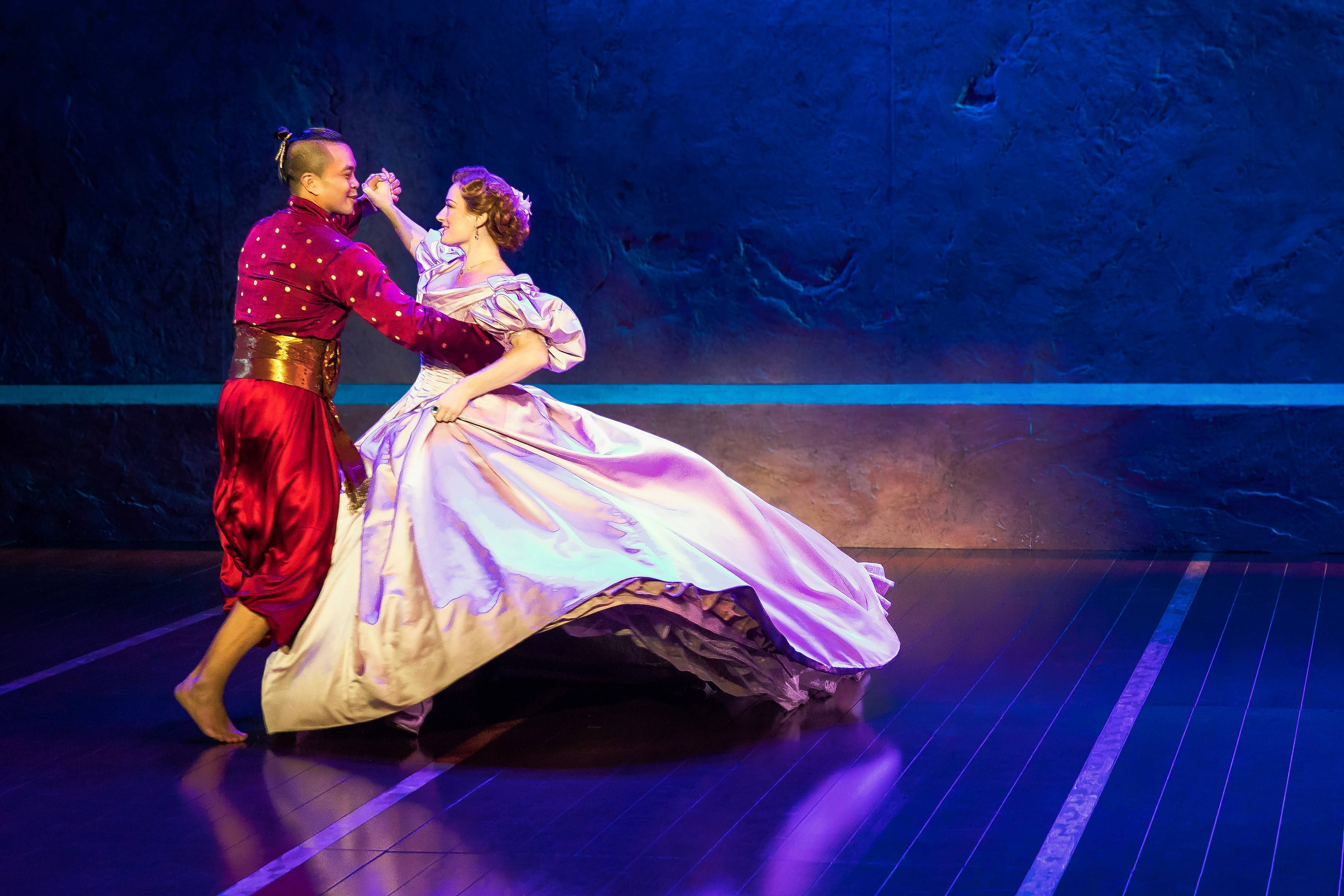 "The King (Jose Llana) learns the polka from Anna (Laura Michelle Kelly) during the song ""Shall We Dance?"" in Lincoln Center Theater's national tour of Rodgers and Hammerstein's ""The King and I,"" which continues at the Oriental Theatre in Chicago."