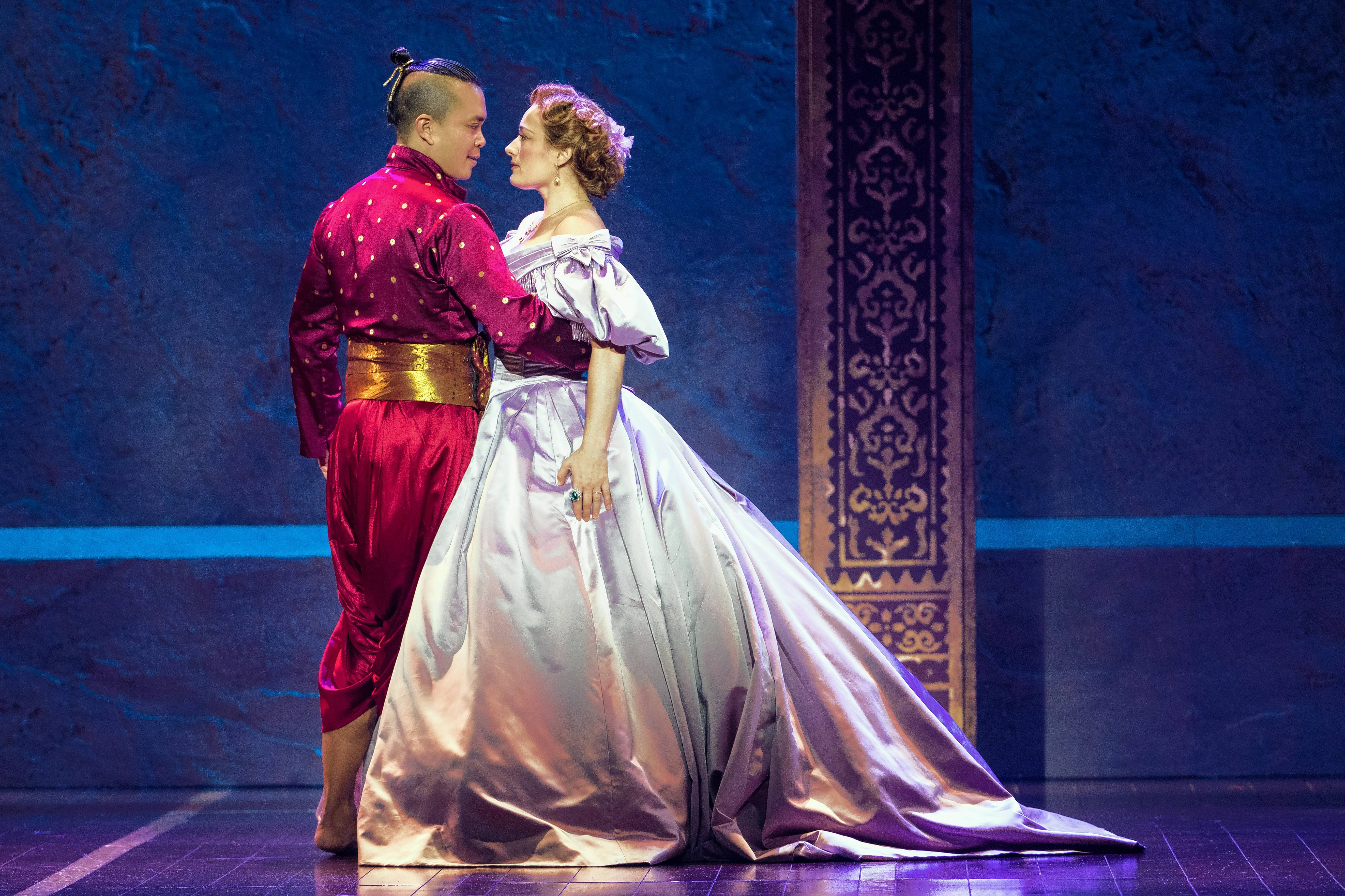 "The King (Jose Llana) learns the polka from Anna (Laura Michelle Kelly) in Lincoln Center Theater's national tour of Rodgers and Hammerstein's ""The King and I,"" which continues at the Oriental Theatre in Chicago."