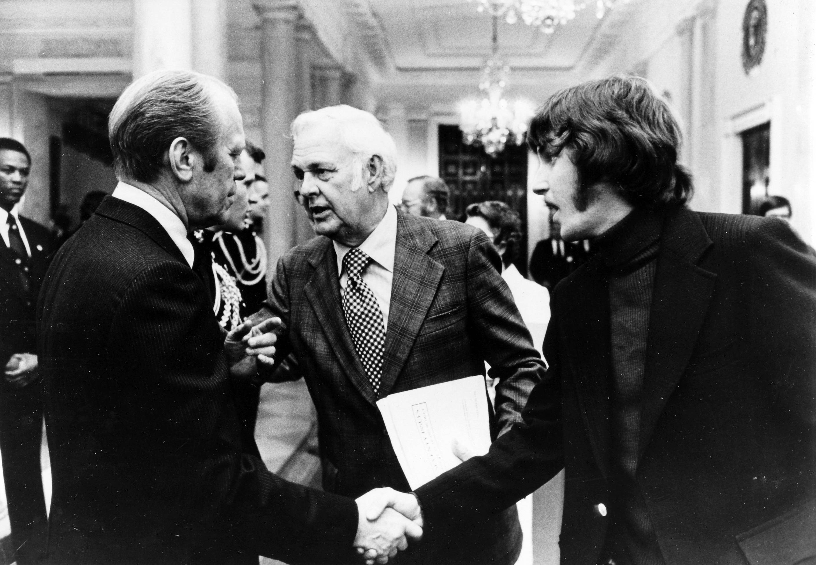 During a press gathering at the White House in 1975, President Gerald R. Ford greets Daily Herald owner and publisher Stuart R. Paddock Jr., center, and his teenage son, Stuart III.