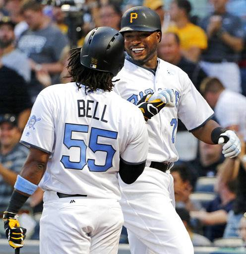 Pittsburgh Pirates' Gregory Polanco, right, celebrates with Josh Bell (55) after hitting a two-run home run off Chicago Cubs starting pitcher Jake Arrieta in the first inning of a baseball game in Pittsburgh, Saturday, June 17, 2017.