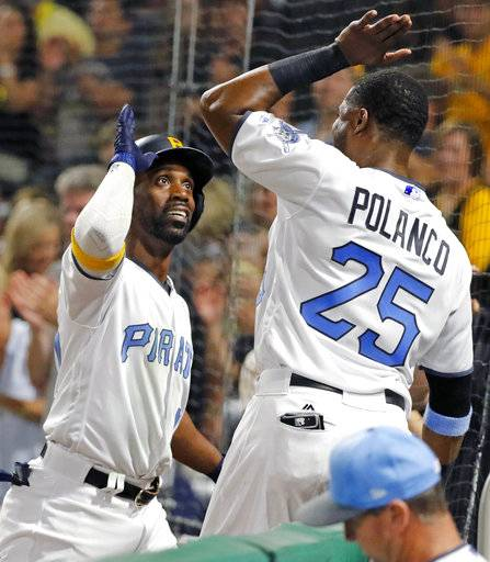 Pittsburgh Pirates' Andrew McCutchen, left, celebrates with Gregory Polanco (25) after hitting a solo-home run off Chicago Cubs relief pitcher Justin Grimm in the sixth inning of a baseball game in Pittsburgh, Saturday, June 17, 2017.