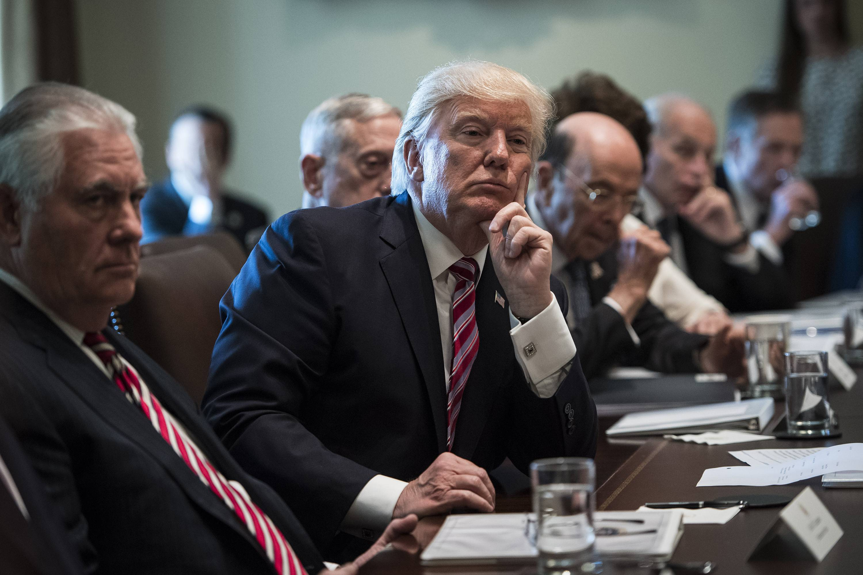 President Donald Trump listens during a Cabinet meeting in the White House on Monday.