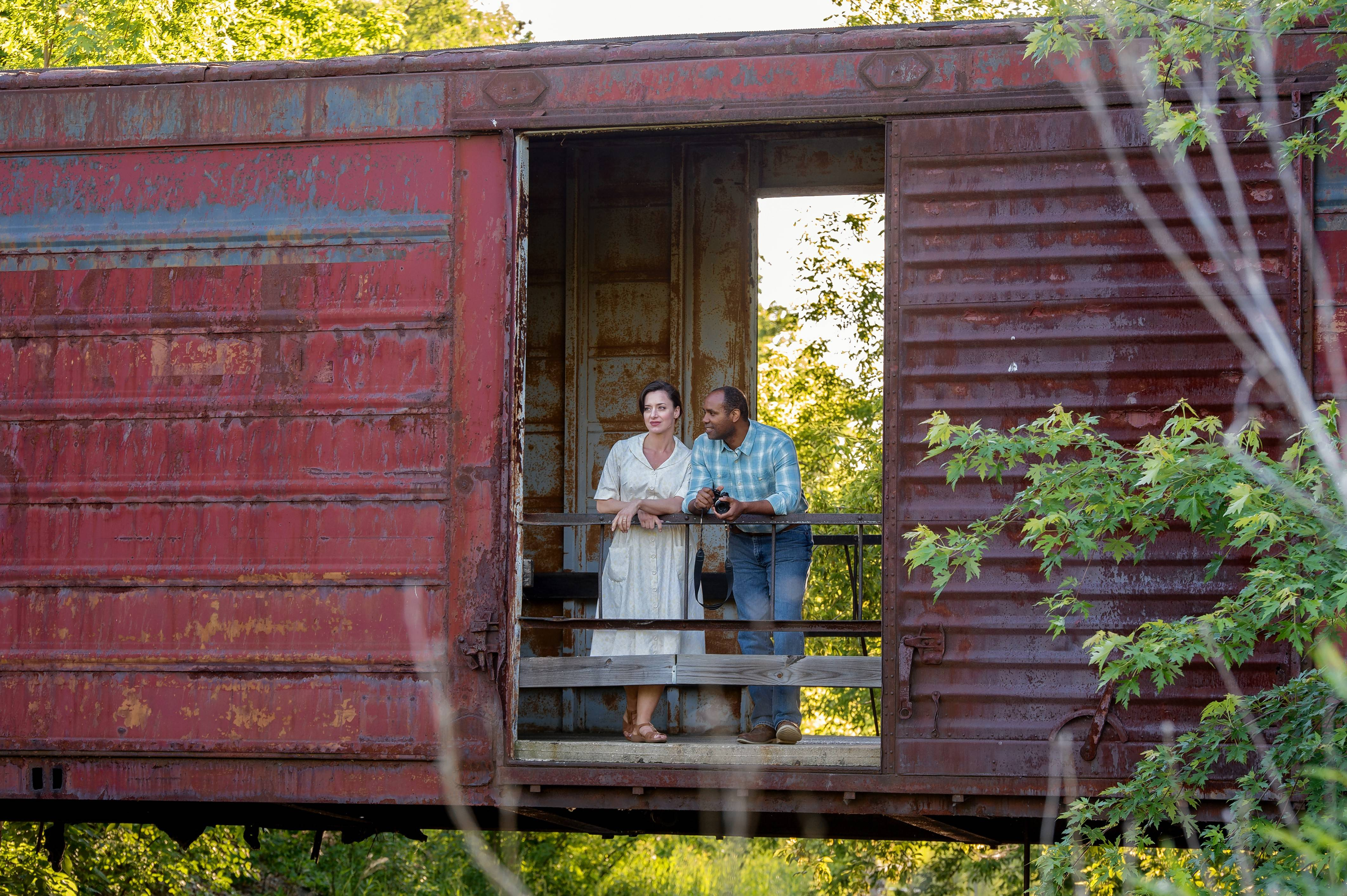 "Broadway veterans Kathy Voytko and Nathaniel Stampley pose on a covered bridge in advance of the Chicago-area premiere of ""The Bridges of Madison County"" at the Marriott Theatre."