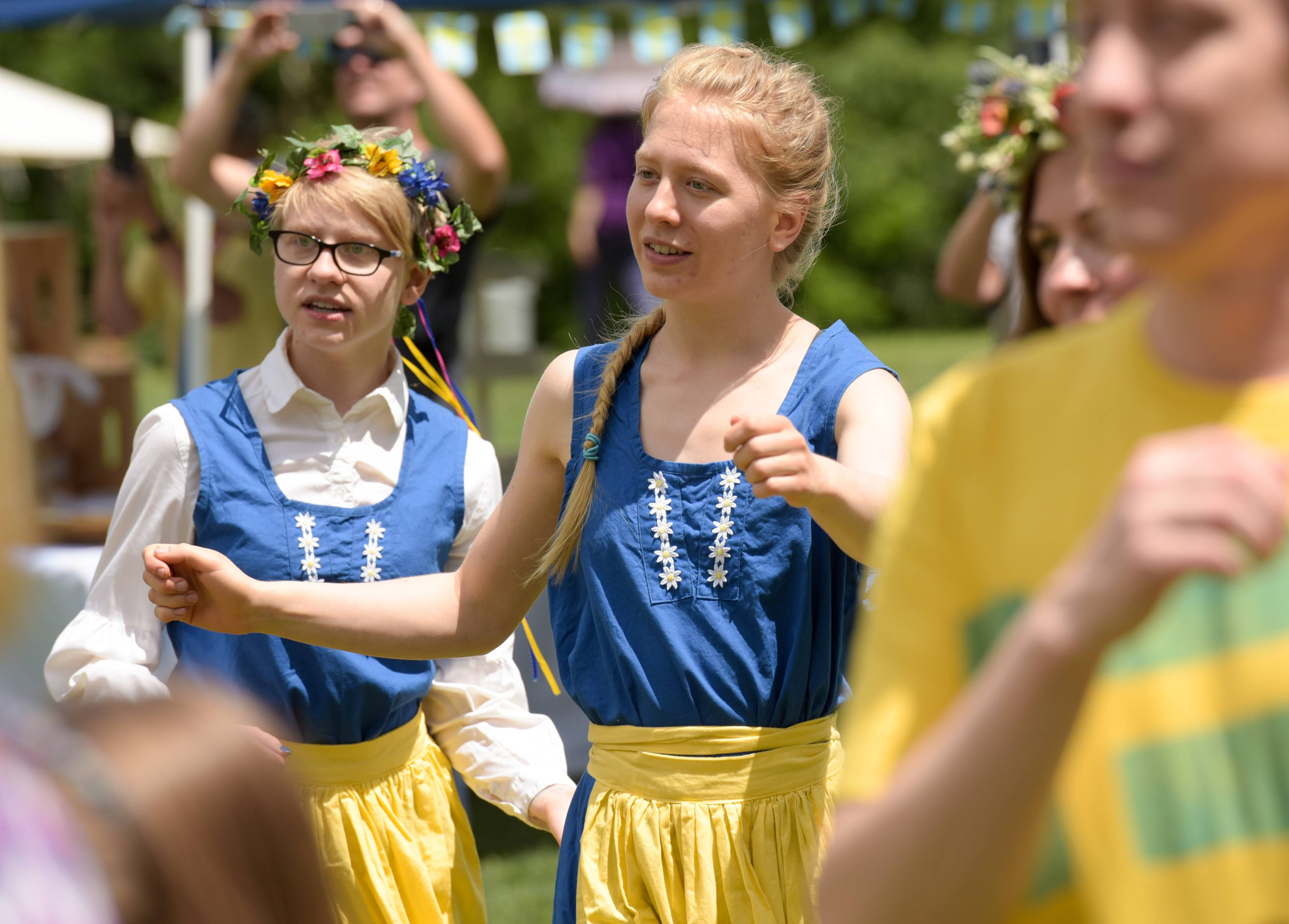 Sisters Kenna and Katya Pospisil of Lake Geneva, Wisconsin, dance around the Maypole Sunday during the annual Swedish Day Midsummer Festival at Good Templar Park in Geneva.