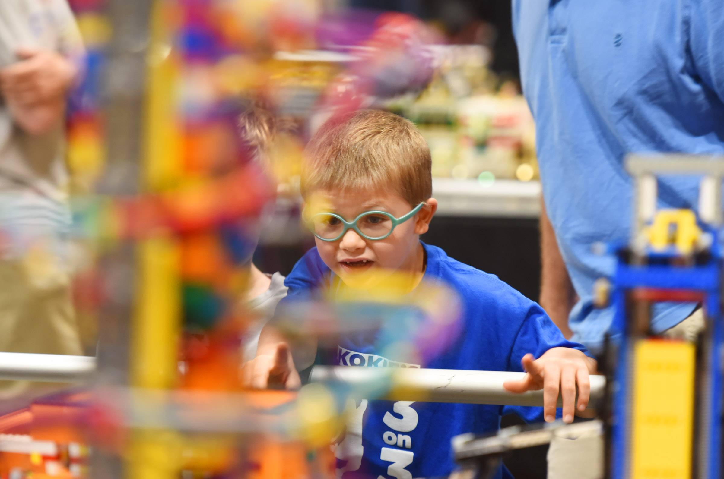 Sawyer Niedfeldt, 6, looks closely at The Great Ball Contraption, a huge Rube Goldberg machine that will move about 50,000 small Lego soccer balls during the weekend at the 10th annual Brickworld Chicago LEGO Exposition at the Schaumburg Renaissance Convention Center. Sawyer was with his dad, Matt Niedfeldt of Skokie, getting ideas for his July birthday.