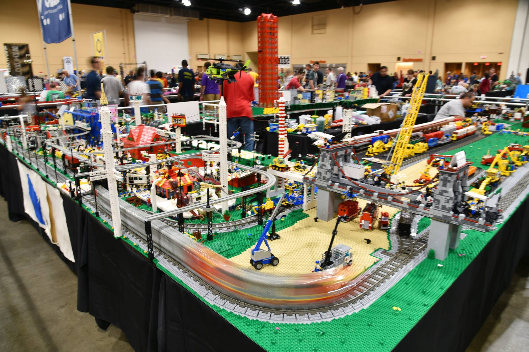 A train follows its track around the corner on a Wisconsin LEGO Users Group setup Sunday, at the 10th annual Brickworld Chicago LEGO Exposition at the Schaumburg Renaissance Convention Center.