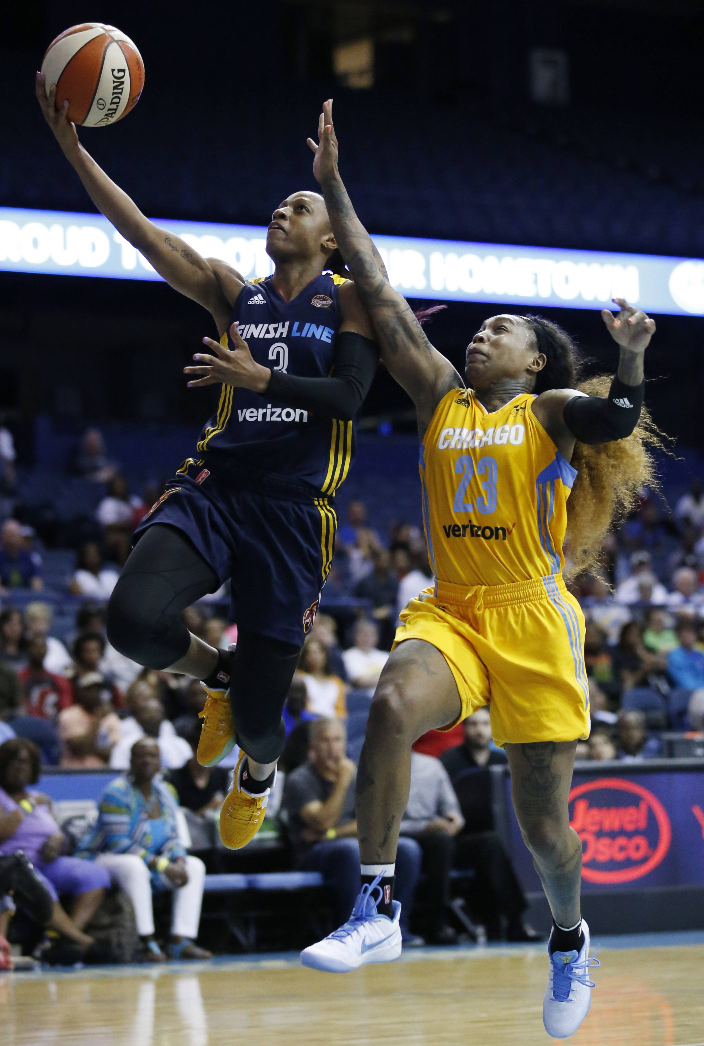 Indiana Fever guard Tiffany Mitchell, left, drives to the basket past Chicago Sky guard Cappie Pondexter during the second half Sunday at Allstate Arena.