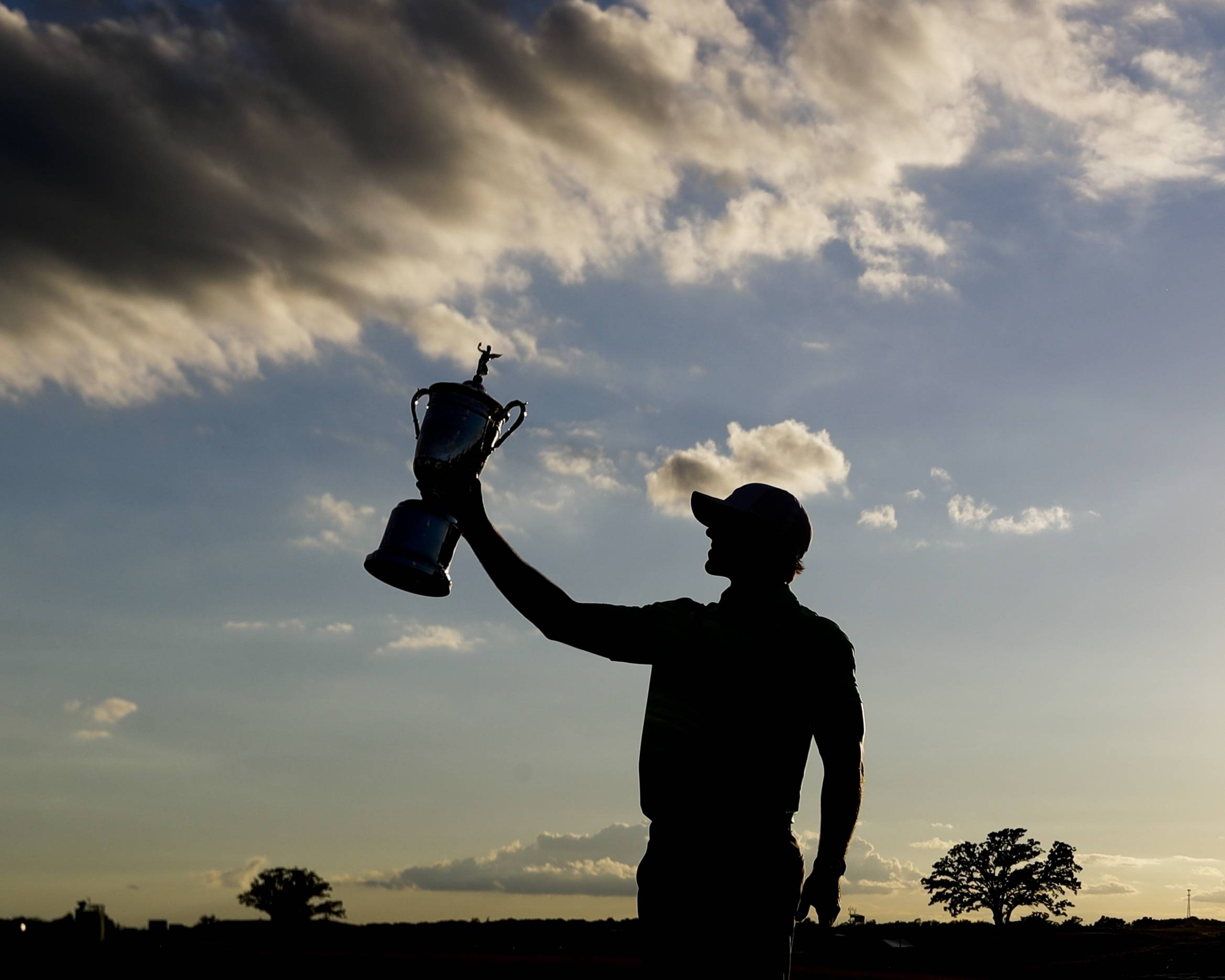 Brooks Koepka poses with the winning trophy after the U.S. Open golf tournament Sunday, June 18, 2017, at Erin Hills in Erin, Wis.