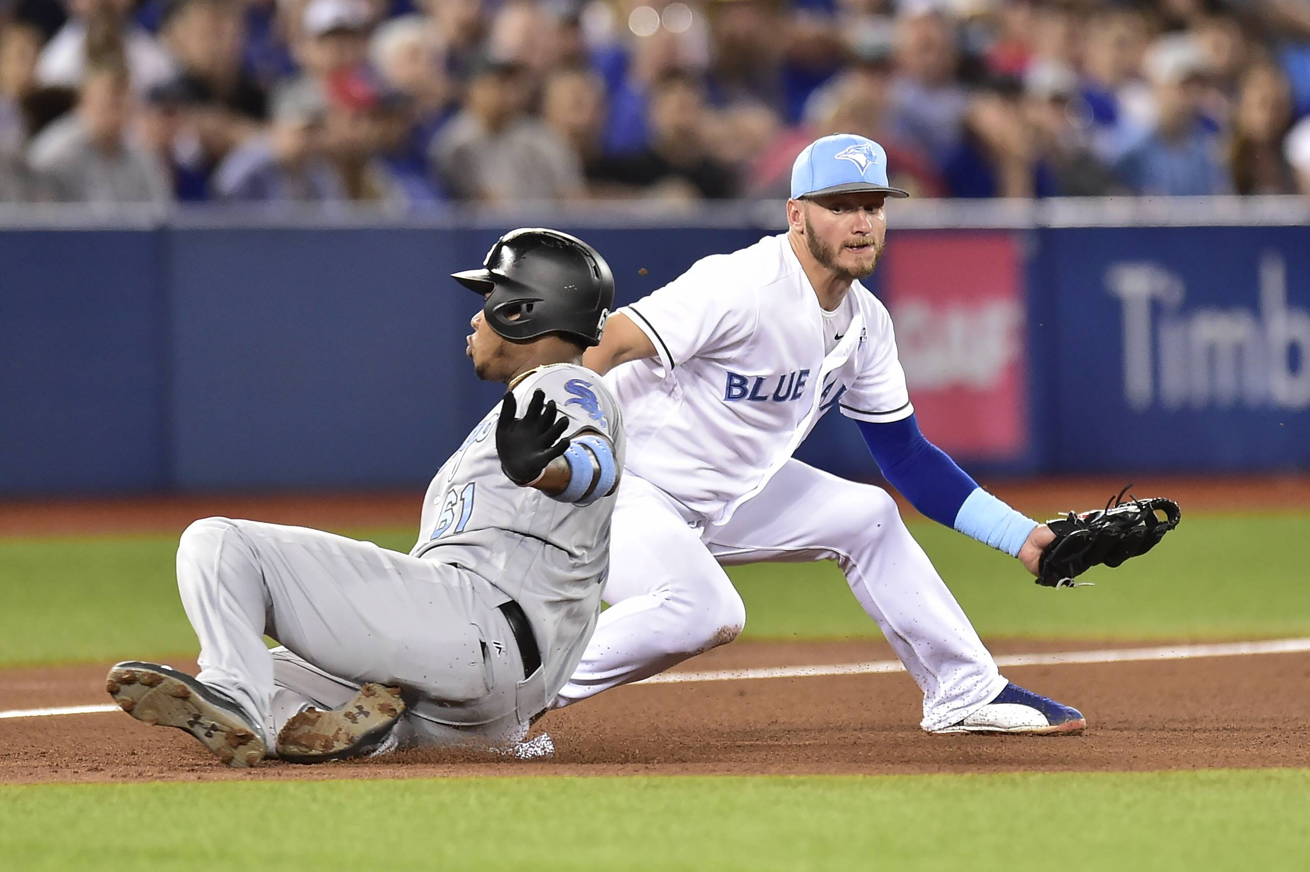 The White Sox's Willy Garcia slides safely into third base ahead of the tag by Toronto Blue Jays third baseman Josh Donaldson (20) during fifth inning American League baseball action in Toronto, Sunday, June 18, 2017. Garcia was advancing on a single by Kevan Smith.