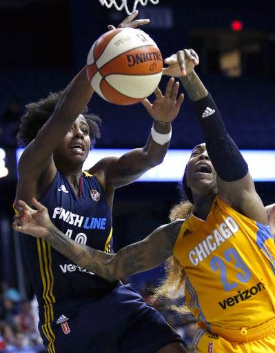 Indiana Fever guard Shenise Johnson, left, and Chicago Sky guard Cappie Pondexter battle for a rebound during the second half of a WNBA basketball game Sunday, June 18, 2017, in Rosemont, Ill.