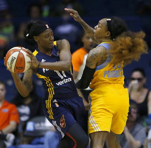 Indiana Fever guard Erica Wheeler, left, looks to pass against Chicago Sky guard Cappie Pondexter during the first half of a WNBA basketball game, Sunday, June 18, 2017, in Rosemont, Ill.