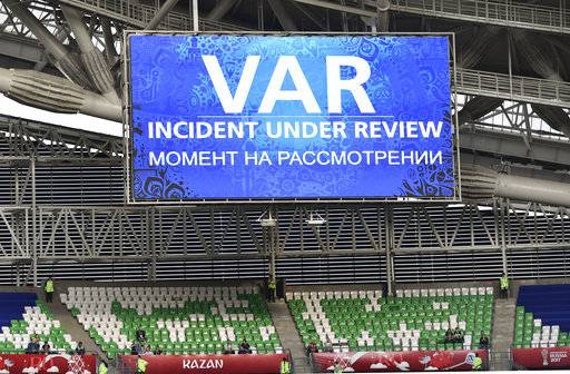 A giant screen reports a VAR incident is being reviewed during the Confederations Cup, Group A soccer match between Portugal and Mexico, at the Kazan Arena, Russia, Sunday, June 18, 2017.