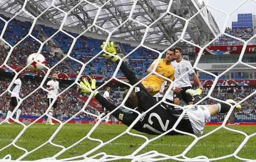 Australia's Tomi Juric, center, scores his side's second goal past Germany goalkeeper Bernd Leno during the Confederations Cup, Group B soccer match between Australia and Germany, at the Fisht Stadium in Sochi, Russia, Monday June 19, 2017.