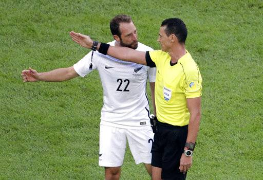 New Zealand's Andrew Durante, left, talks with referee Wilmar Roldan during the Confederations, Cup Group A soccer match between Russia and New Zealand, at the St.Petersburg stadium in St.Petersburg, Russia, Saturday, June 17, 2017.