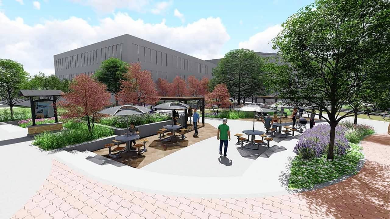New benches, tables, shade covers and landscaping will be part of a roughly $400,000 outdoor office plaza the city of Naperville is planning for the grassy area between the municipal center and the Riverwalk.