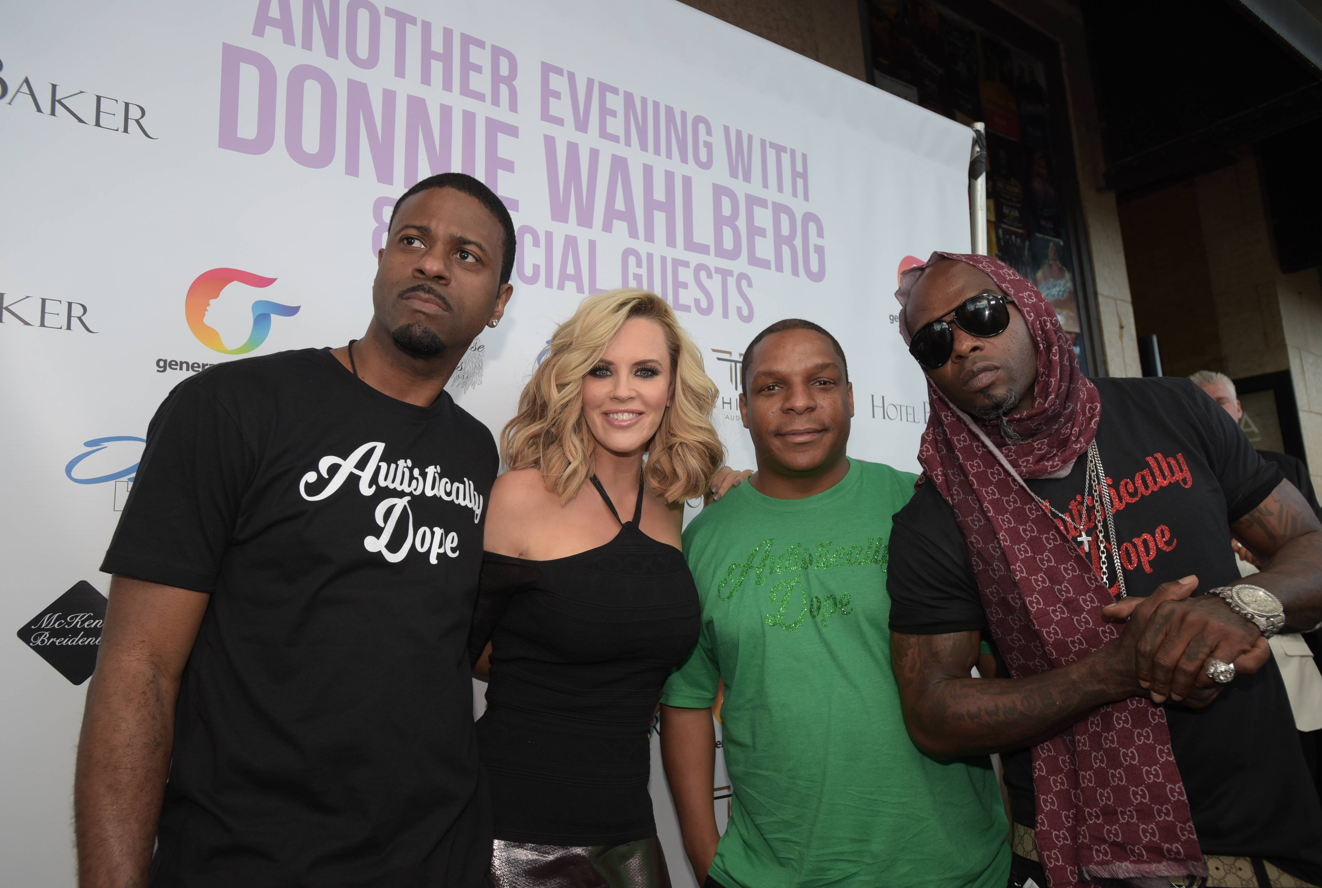"Jenny McCarthy poses on the red carpet Monday with Naughty by Nature, who were all sporting ""Autistically Dope"" T-shirts. McCarthy's husband Donnie Wahlberg performed a concert in St. Charles at the Arcada Theatre to raise money and awareness for Generation Rescue."