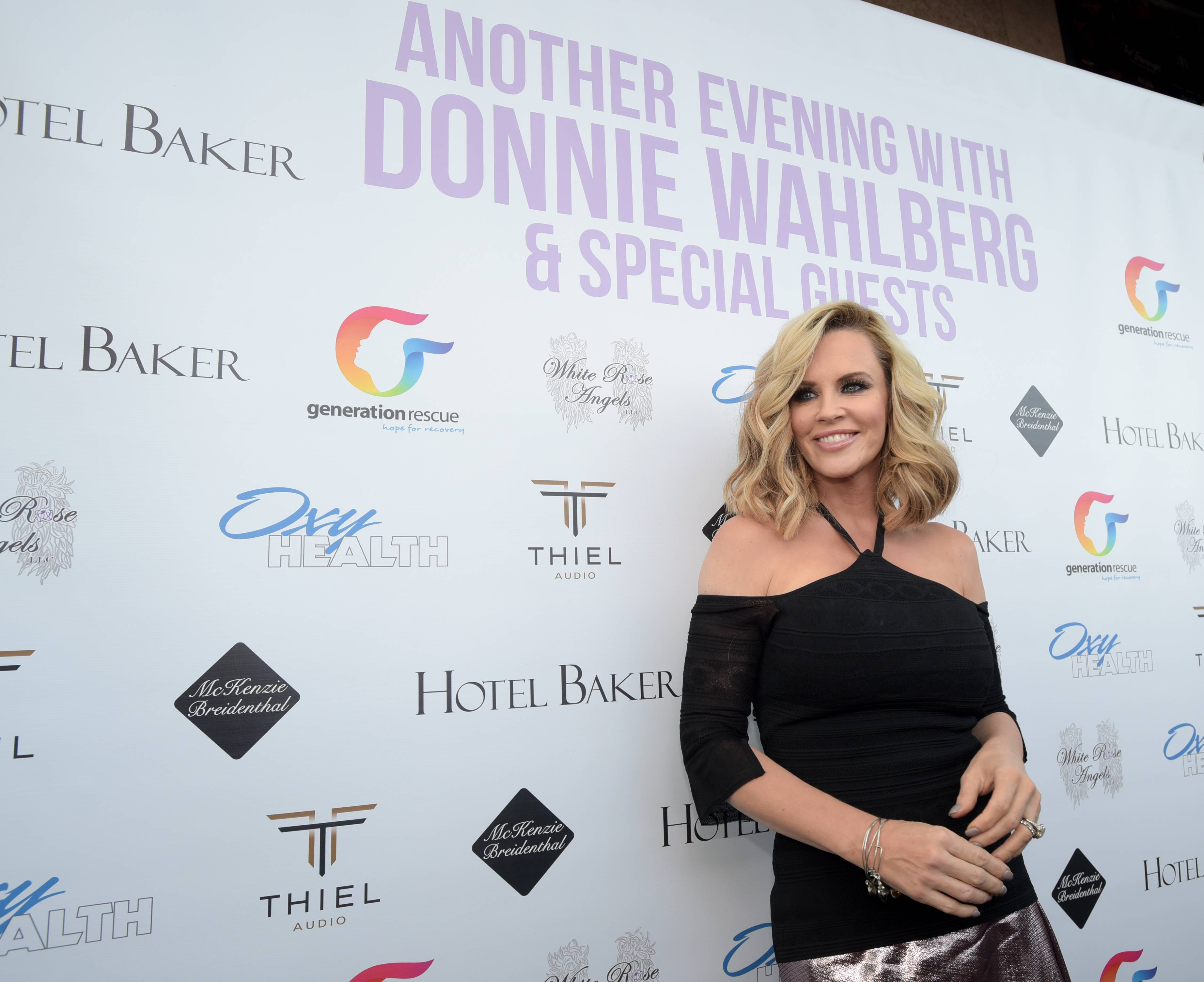 Jenny McCarthy poses on the red carpet Monday before her husband Donnie Wahlberg performs a concert in St. Charles at the Arcada Theatre to raise money and awareness for Generation Rescue.