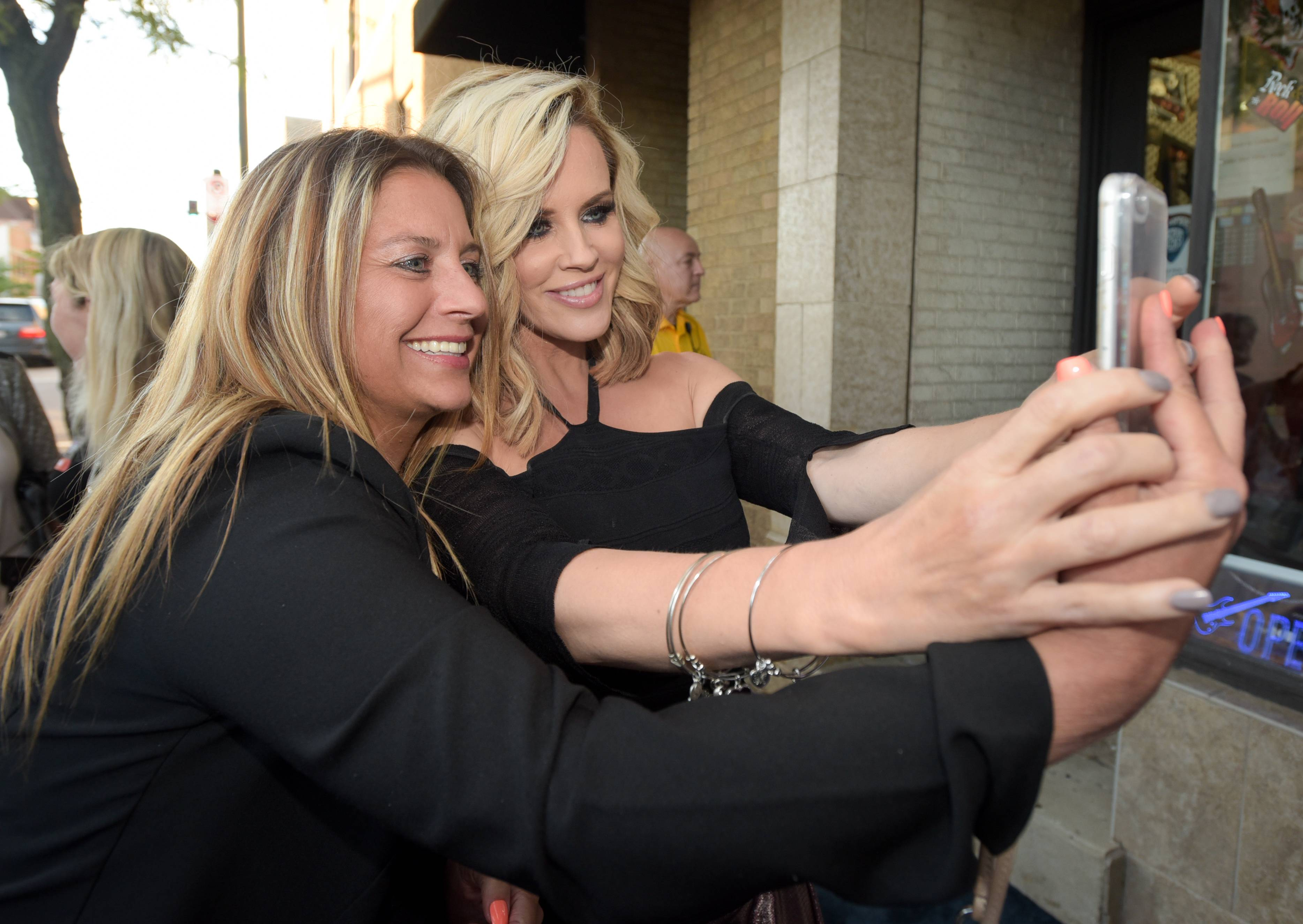 Kindergarten teacher Sherrie Klint of Elburn takes a selfie with Jenny McCarthy before McCarthy's husband, Donnie Wahlberg, performs in a concert in St. Charles at the Arcada Theatre to benefit Generation Rescue, which raises money for autism treatments. McCarthy's son, Evan, was diagnosed with autism in 2005.