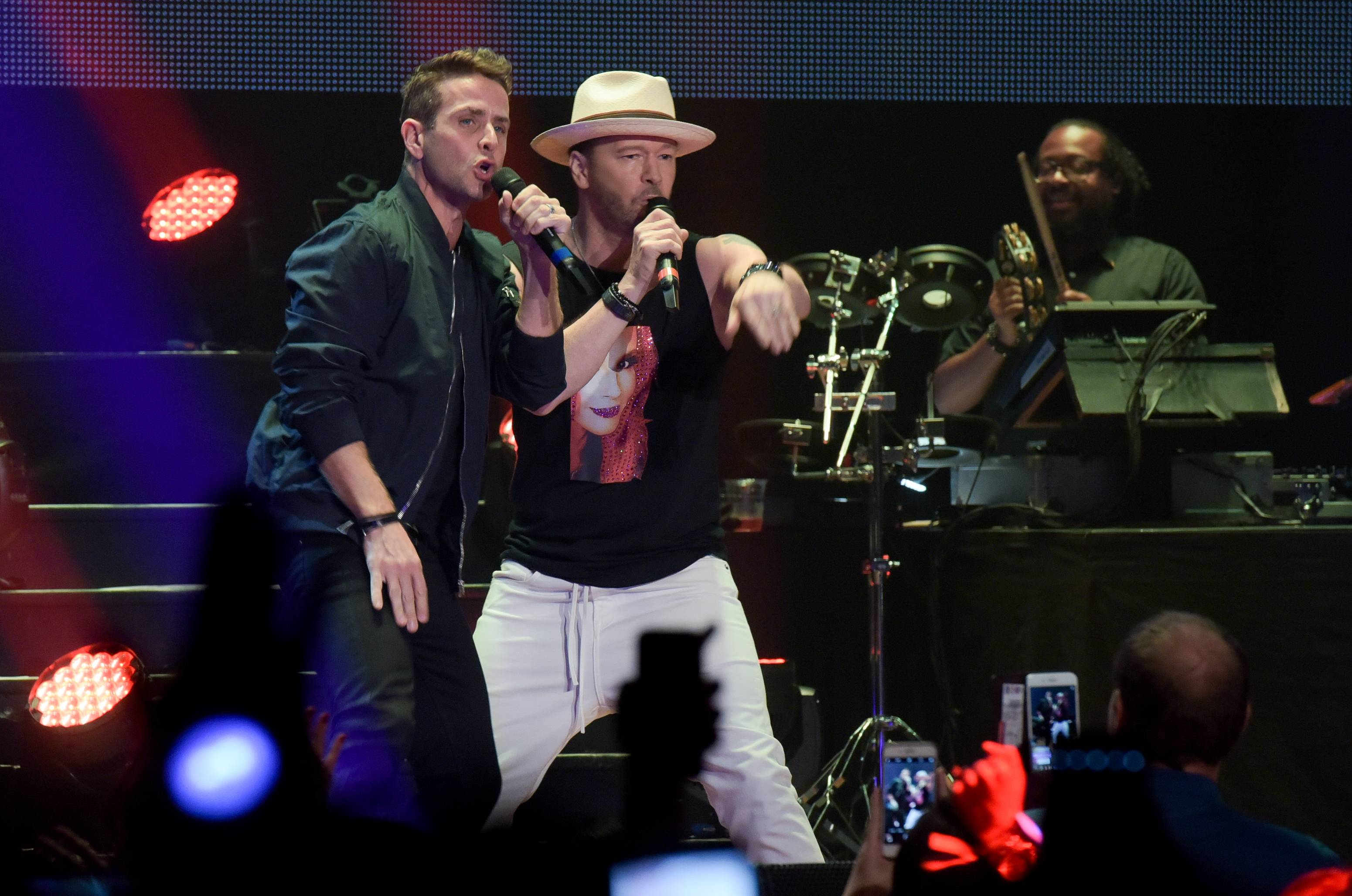 Fellow New Kids on the Block member Joey McIntyre, left, performs alongside Donnie Wahlberg on Monday during an autism benefit concert in St. Charles at the Arcada Theatre.