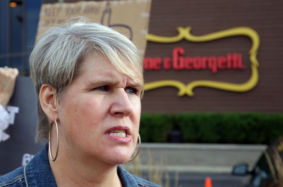 Clare Duggan of Beverly explains why she joined other protesters outside the Illinois GOP fundraiser Monday at Gene & Georgetti steakhouse in Rosemont.