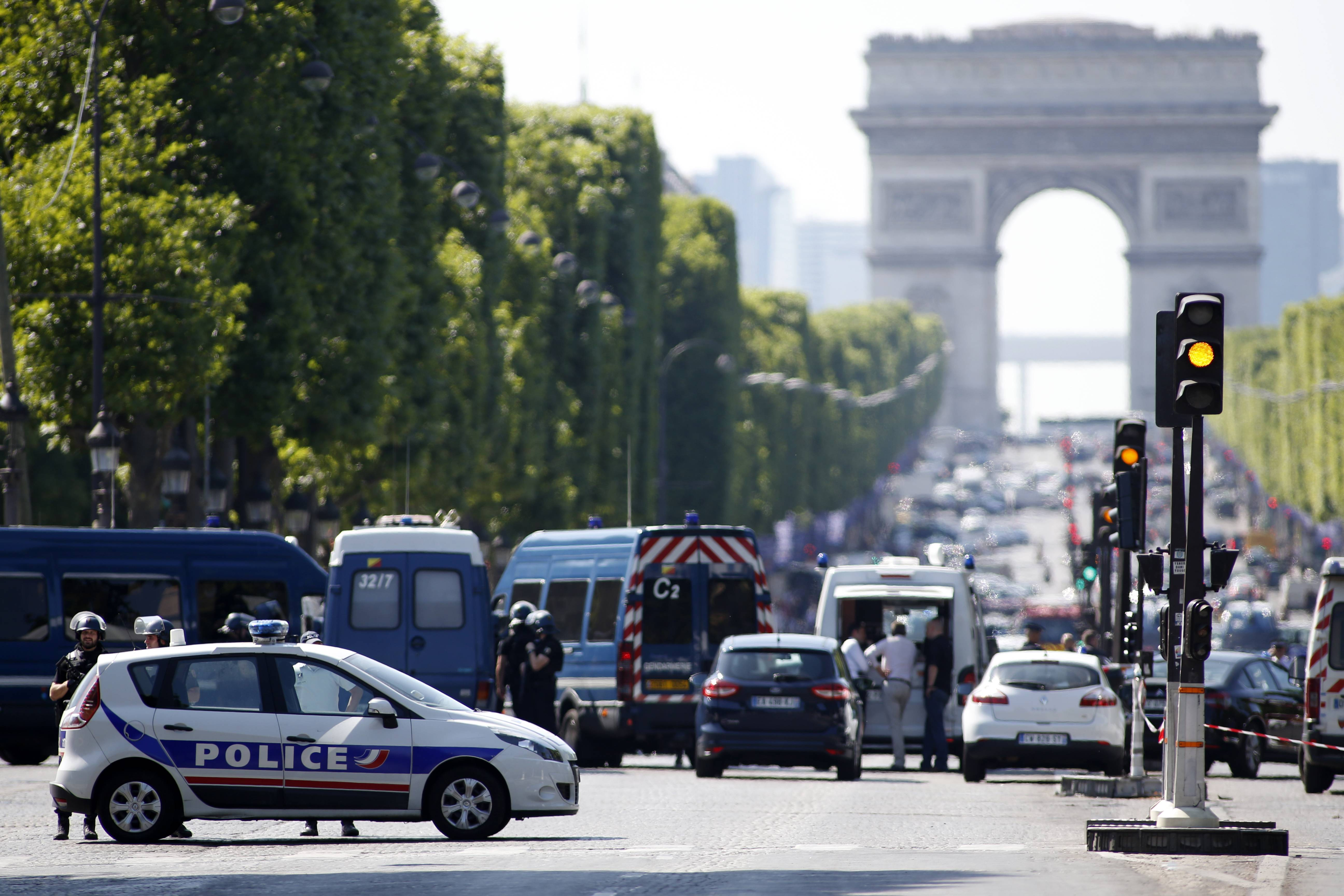 Police forces secure the area on the Champs Elysées in Paris, Monday. A driver rammed his car into a police vehicle in the Champs-Élysées shopping district Monday, prompting a fiery explosion, and was likely killed in the incident, authorities said. France's anti-terrorism prosecutor opened an investigation.