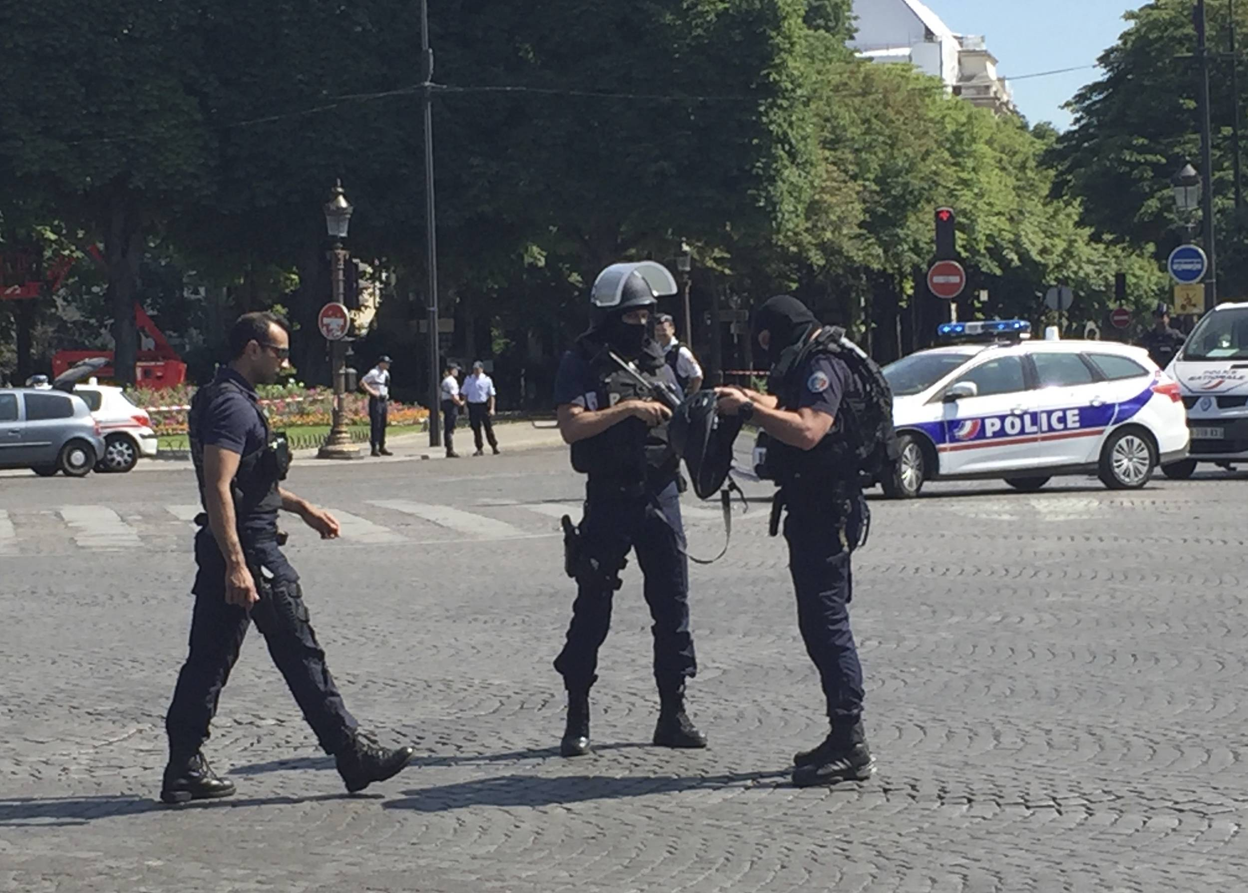 Police officers seal off the access to the Champs Elysees avenue in Paris, France, Monday, June 19, 2017. Paris officials say: Suspected attacker 'downed' after driving into police car on Champs-Élysées.