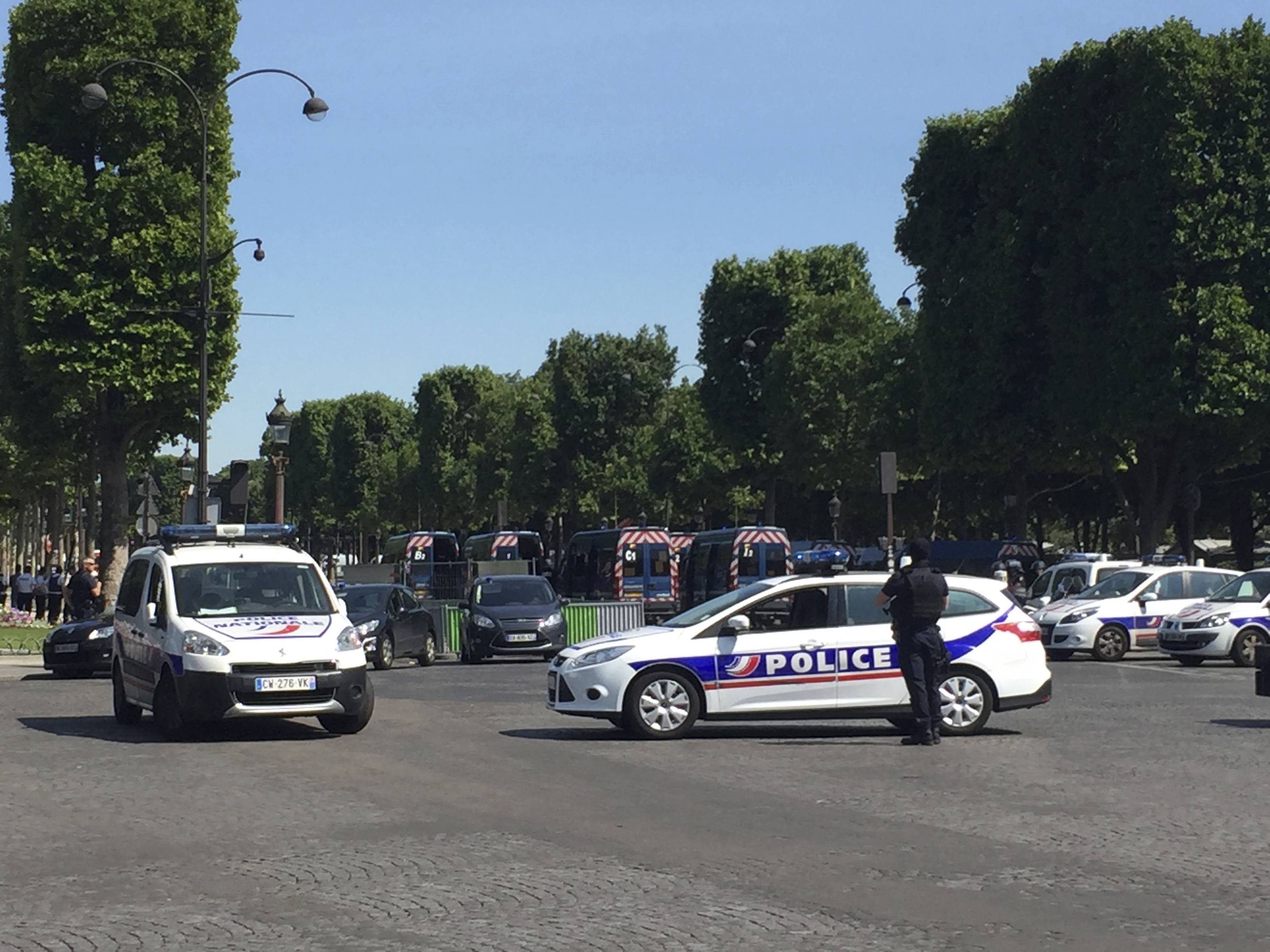 Police vehicles prevent the access to the Champs Elysees avenue in Paris, France, Monday, June 19, 2017. Paris officials say: Suspected attacker 'downed' after driving into police car on Champs-Élysées.
