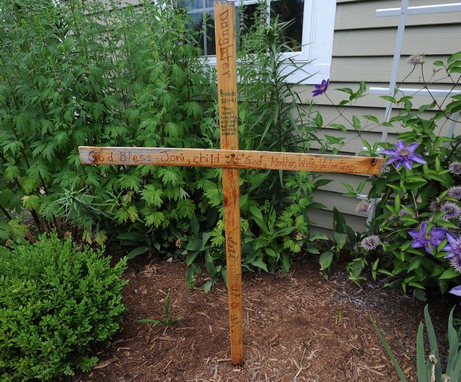 A cross stands in the garden to honor Joni Beaudry.