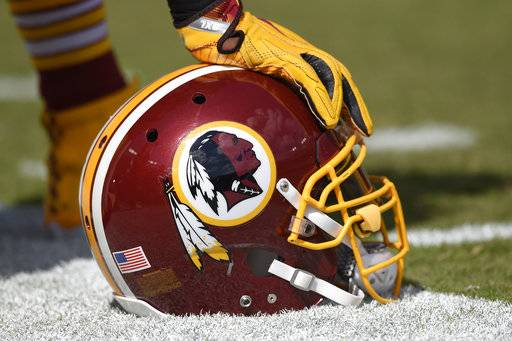 FILE - In this Sept. 18, 2016 file photo, a Washington Redskins helmet is seen on the sidelines during the first half of an NFL football game against the Dallas Cowboys in Landover, Md. The Supreme Court on Monday, June 19, 2017, struck down part of a law that bans offensive trademarks in a ruling that is expected to help the Washington Redskins in their legal fight over the team name.