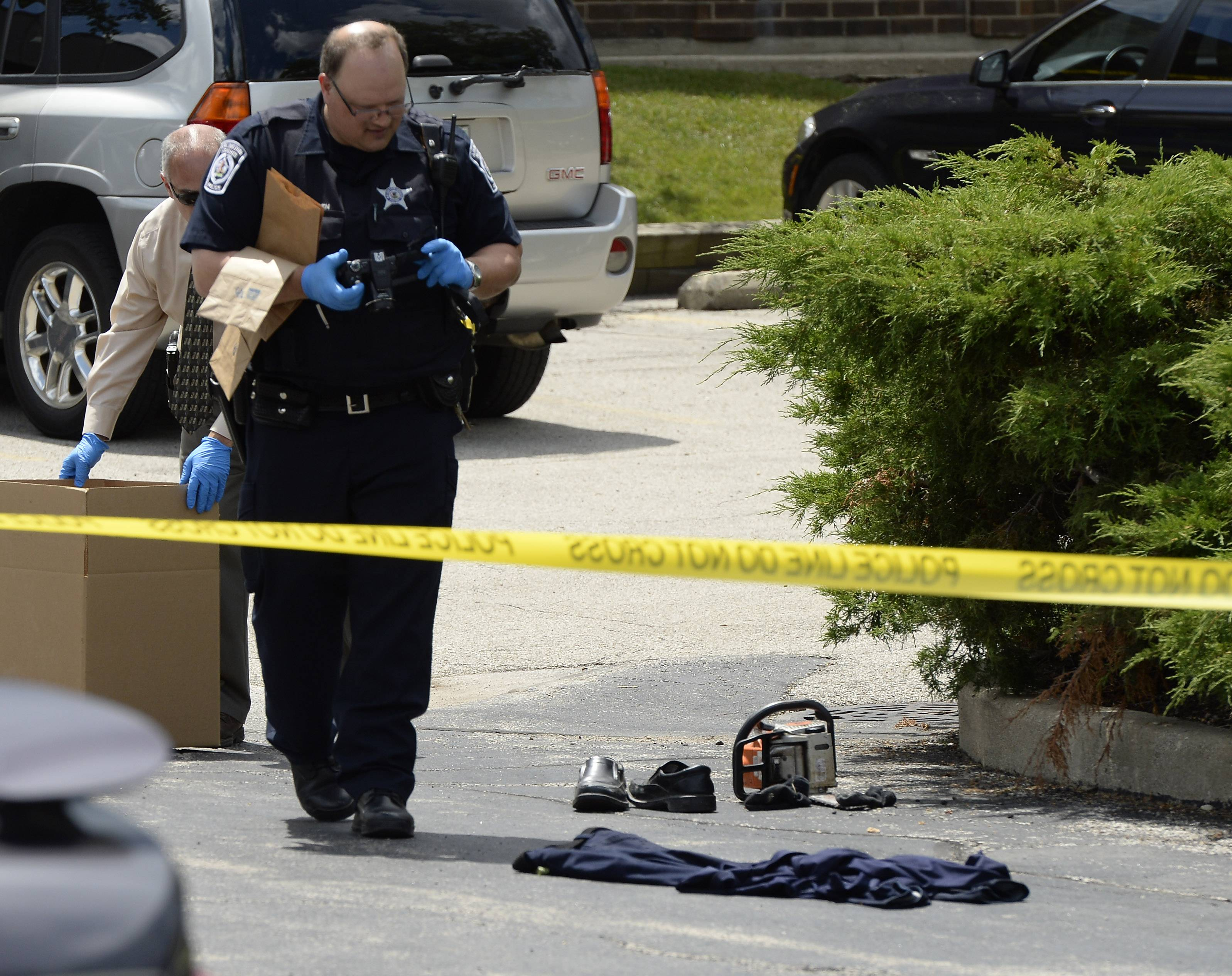 Arlington Heights police gather bloody clothes, a chain saw and other evidence in a domestic dispute that turned violent in Arlington Heights on Monday.