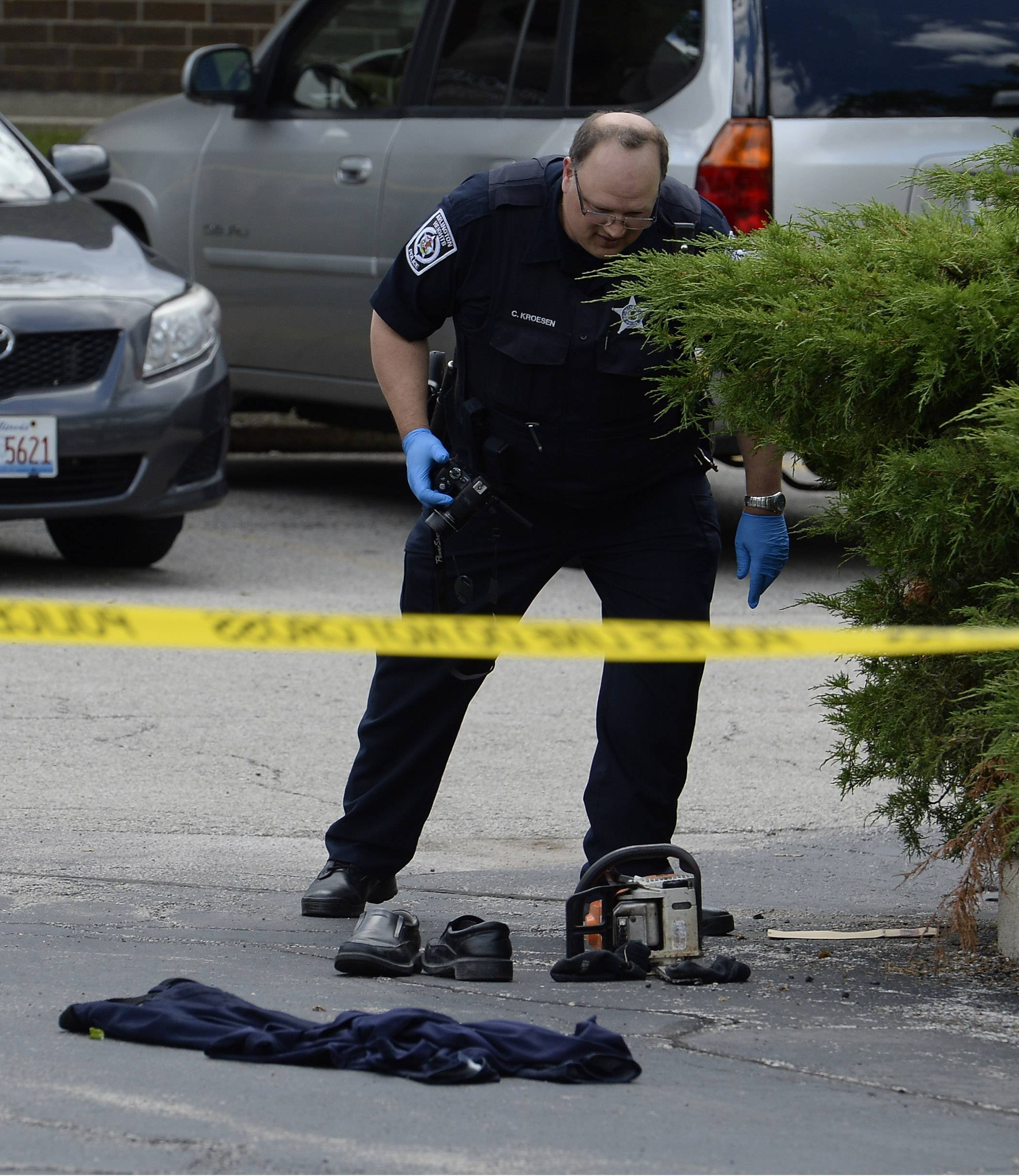 Arlington Heights police gather evidence, bloody clothes and a chain saw after a domestic case turned violent in Arlington Heights on Monday.