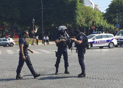 Police officers seal off the access to the Champs Elysees avenue in Paris, France, Monday, June 19, 2017. Paris officials say : Suspected attacker 'downed' after driving into police car on Champs-Elysees.