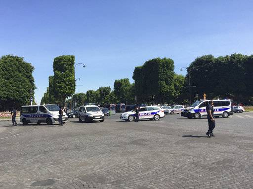 Police vehicles prevent the access to the Champs Elysees avenue in Paris, France, Monday, June 19, 2017. Paris officials say : Suspected attacker 'downed' after driving into police car on Champs-Elysees.