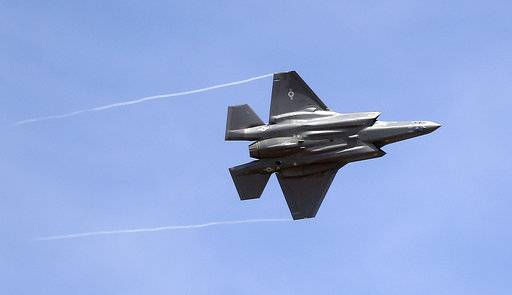FILE - In this Wednesday, Sept. 2, 2015, file photo, an F-35 jet arrives at its new operational base at Hill Air Force Base, in northern Utah. Airbus and Boeing will again hog the spotlight at the Paris Air Show with their battle for ever-larger slices of the lucrative pie in the sky.