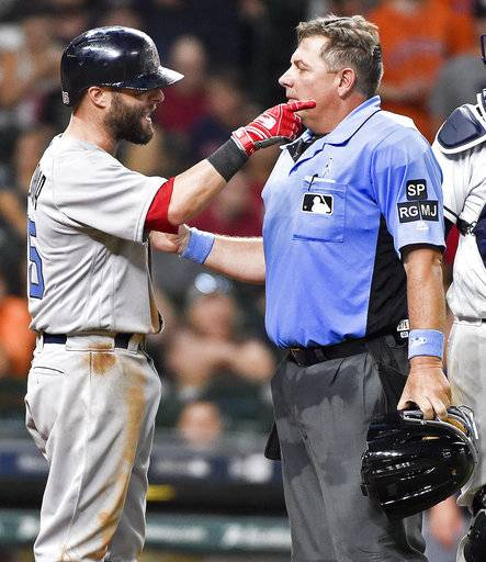 Boston Red Sox' Dustin Pedroia argues with home plate umpire Greg Gibson after Pedroia was hit by a pitch by Houston Astros relief pitcher James Hoyt during the seventh inning of a baseball game, Sunday, June 18, 2017, in Houston.