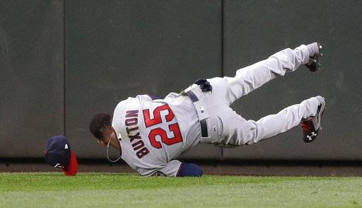 FILE - In this Thursday, June 8, 2017, file photo, Minnesota Twins center fielder Byron Buxton lands after making a leaping catch of a line drive hit by Seattle Mariners' Robinson Cano during the fifth inning of a baseball game in Seattle. The Twins were thoroughly beaten during a four-game sweep over the weekend by the Cleveland Indians, losing their lead in the AL Central in the process. But the primary reason the Twins were there in the first place as one of baseball's most surprising teams has been a vast improvement in their defense, the third and most-overlooked phase of the game.