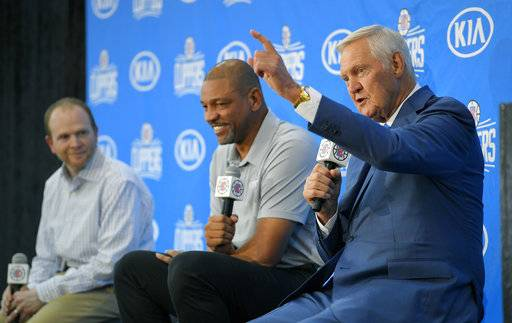 Jerry West, right, speaks during a news conference to introduce him as an advisor to the Los Angeles Clippers as Clippers executive vice president of basketball operations Lawrence Frank, left, and president of basketball operations and head coach Doc Rivers listen, Monday, June 19, 2017, in Los Angeles.