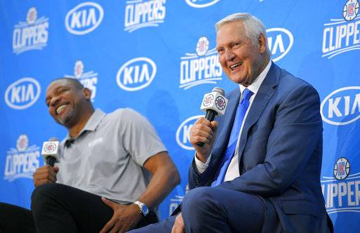 Jerry West, right, speaks during a news conference to introduce him as an advisor to the Los Angeles Clippers as president of basketball operations and head coach Doc Rivers laughs, Monday, June 19, 2017, in Los Angeles.