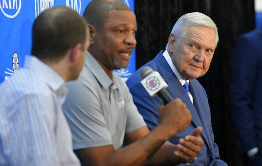 Los Angeles Clippers president of basketball operations and head coach Doc Rivers, center, speaks as Jerry West, right, listens along with Clippers executive vice president of basketball operations Lawrence Frank during a news conference to introduce West as an advisor to the Los Angeles Clippers, Monday, June 19, 2017, in Los Angeles.