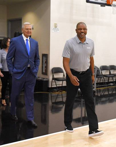Jerry West, left, walks out for a news conference with Los Angeles Clippers president of basketball operations and head coach Doc Rivers to introduce West as an advisor to the Clippers, Monday, June 19, 2017, in Los Angeles.