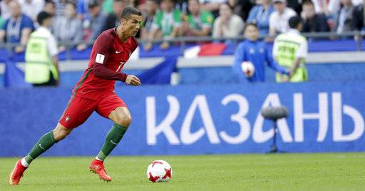 Portugal's Cristiano Ronaldo runs with the ball during the Confederations Cup, Group A soccer match between Portugal and Mexico, at the Kazan Arena, Russia, Sunday, June 18, 2017.