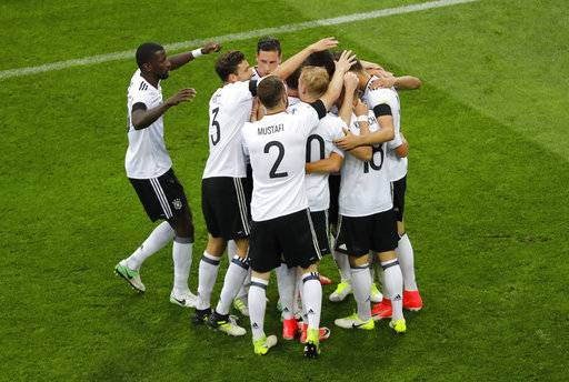 Germany's Leon Goretzka is congratulated by teammates after he scored his side's third goal during the Confederations Cup, Group B soccer match between Australia and Germany, at the Fisht Stadium in Sochi, Russia, Monday, June 19, 2017.