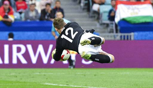 Germany goalkeeper Bernd Leno dives for the ball during the Confederations Cup, Group B soccer match between Australia and Germany, at the Fisht Stadium in Sochi, Russia, Monday, June 19, 2017.