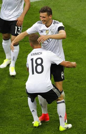 Germany's Leon Goretzka, right, is congratulated by Joshua Kimmich after he scored his side's third goal during the Confederations Cup, Group B soccer match between Australia and Germany, at the Fisht Stadium in Sochi, Russia, Monday, June 19, 2017.