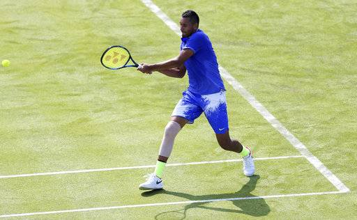 Australia's Nick Kyrgios in action in his match against USA's Donald Young, during day one of the  Queen's Club Championships in London, England, Monday June 19, 2017. Kyrgios retired with an injury after losing the opening set 7-6 (3), the latest setback for the Australian player. (Steven Paston/PA via AP)