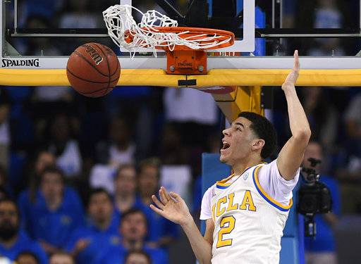 FILE - In this Saturday, March 4, 2017, file photo, UCLA guard Lonzo Ball dunks during the first half of an NCAA college basketball game against Washington State in Los Angeles. Ball is expected to be a top pick at the NBA Draft on Thursday, June 22.