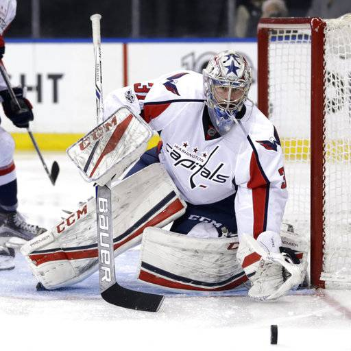 FILE - In this Sunday, Feb. 19, 2017, file photo, Washington Capitals goalie Philipp Grubauer defends the net during the second period of an NHL hockey game against the New York Rangers in New York. The Vegas Golden Knights GM might as well be The Godfather of the NHL during a three-day expansion draft window. The expansion draft rules made it so that Vegas would wind up with strong enough goaltending to be competitive even in its inaugural season. There's also a surplus of young goaltending talent, including Detroit's Petr Mrazek, Washington's Grubauer, the New York Rangers' Antti Raanta and Colorado's Calvin Pickard.