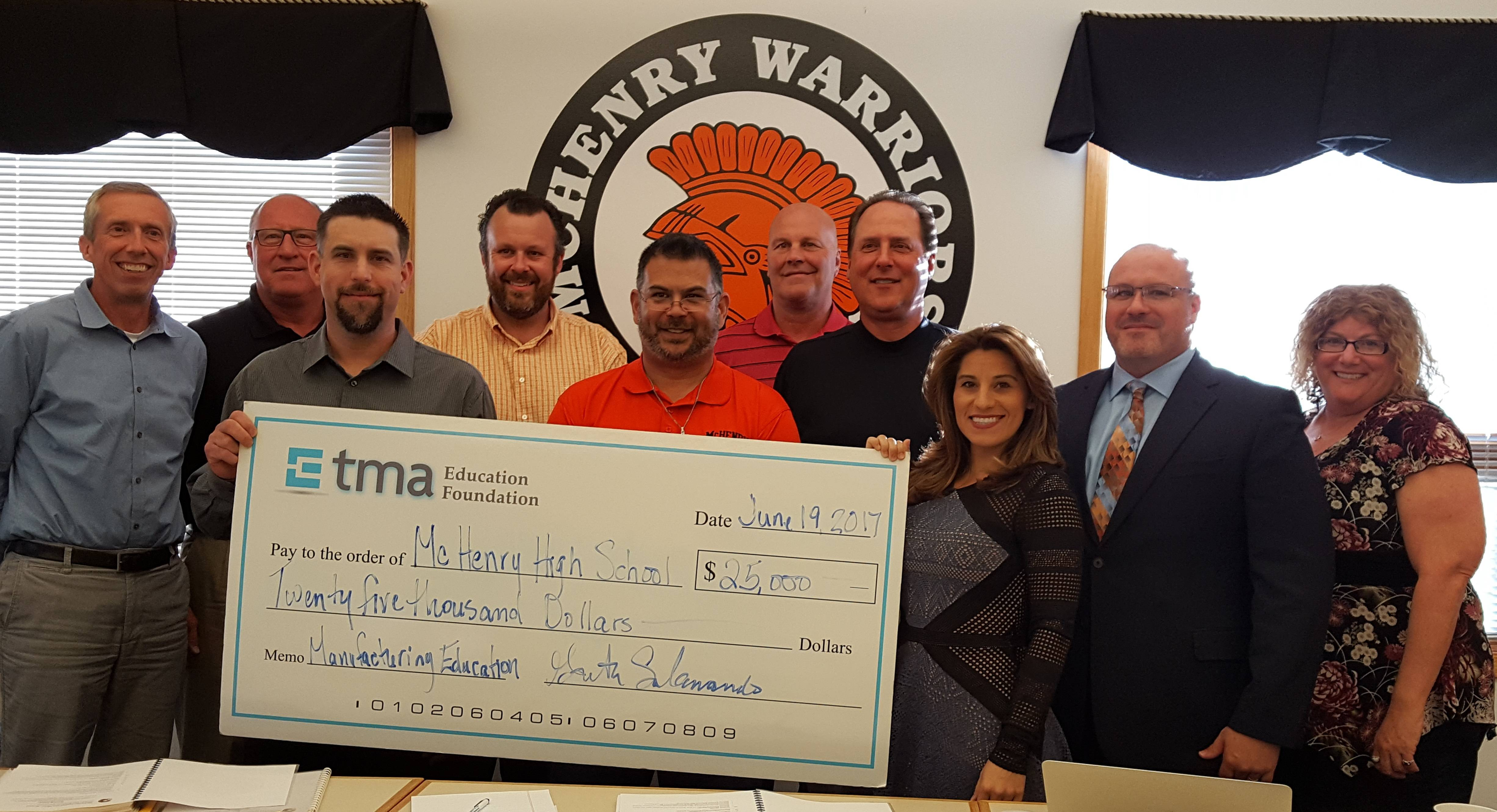 TMA Education Foundation presented McHenry High Schools a grant check totaling $25,000. The grant fulfilled the schools' request for funds to purchase two refurbished Monarch 10EE lathes.TMA Illinois